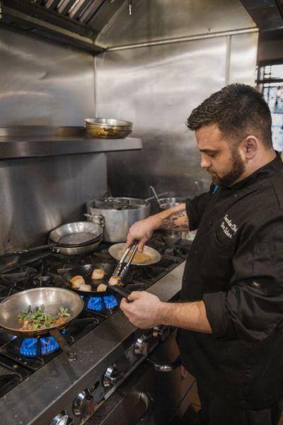 Chef Dan Luber prepares pan seared scallops at Center Square Tavern